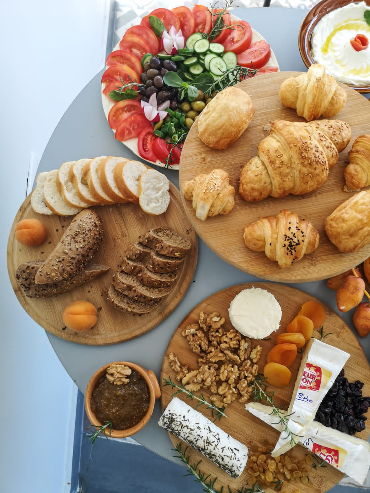 Charcuterie boards and baked croissants and pastries