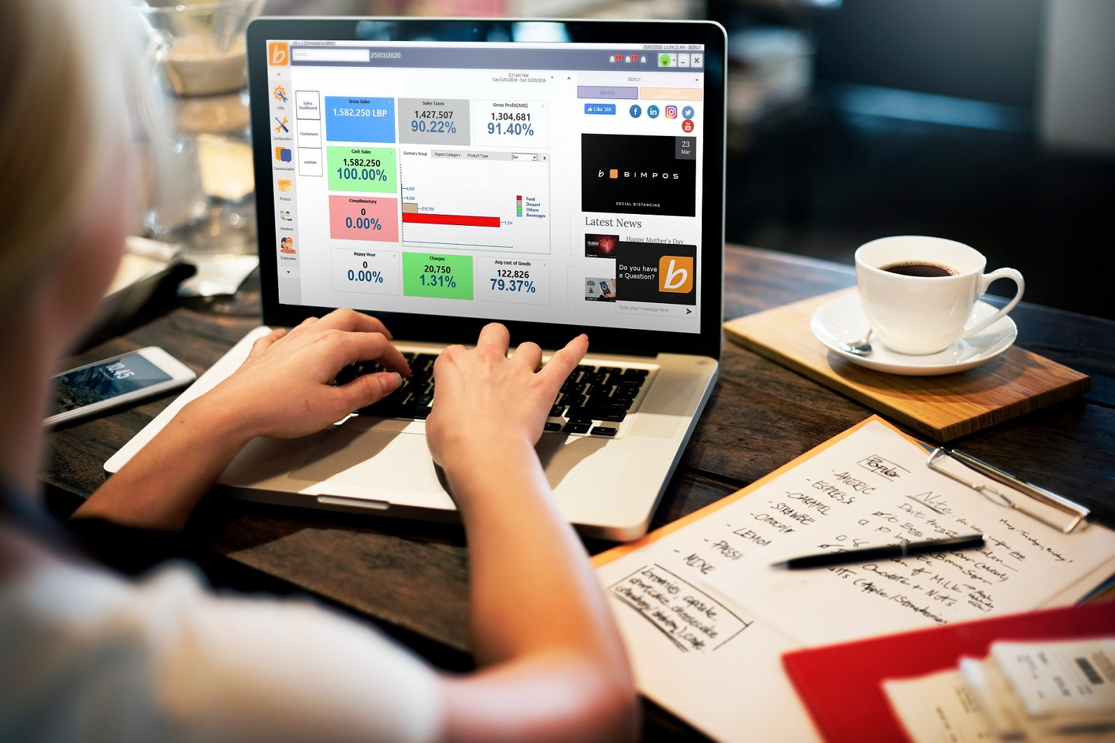 An employee working on the restaurant management system and managing inventory and CRM