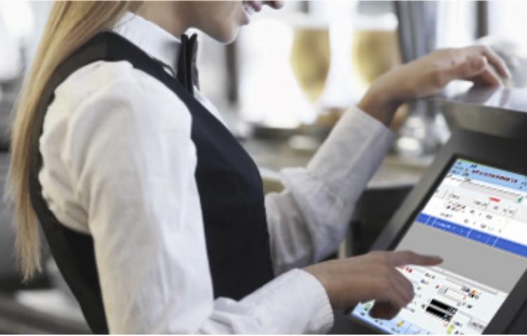 A waitress using restaurant POS