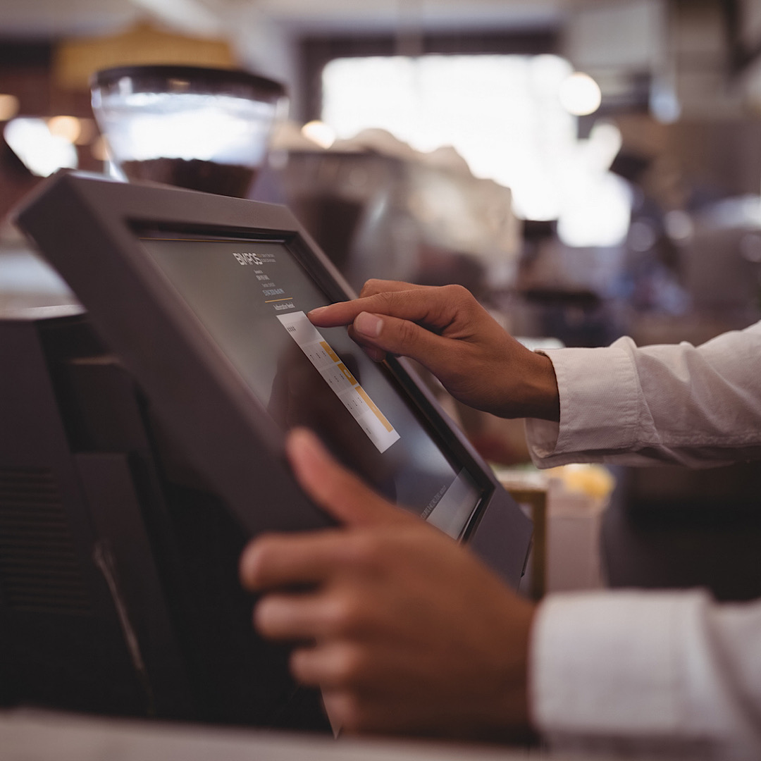 A waiter working on the restaurant management system