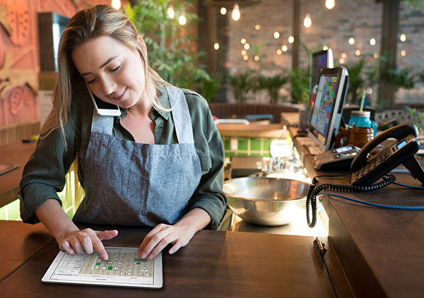 A waitress using the reservation software to make table reservations