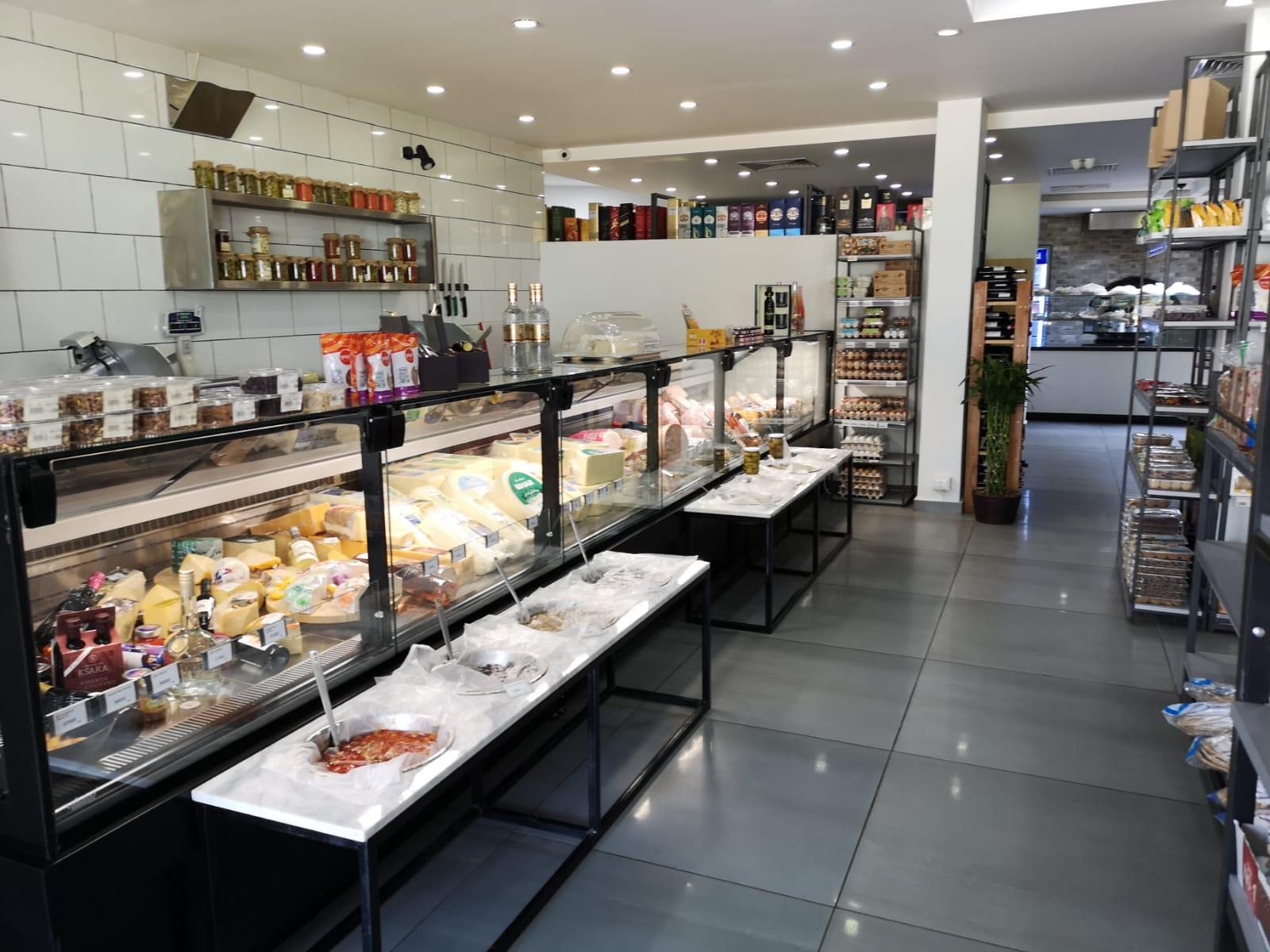 A picture of Everyday bakery café display of cheese and deli fridge