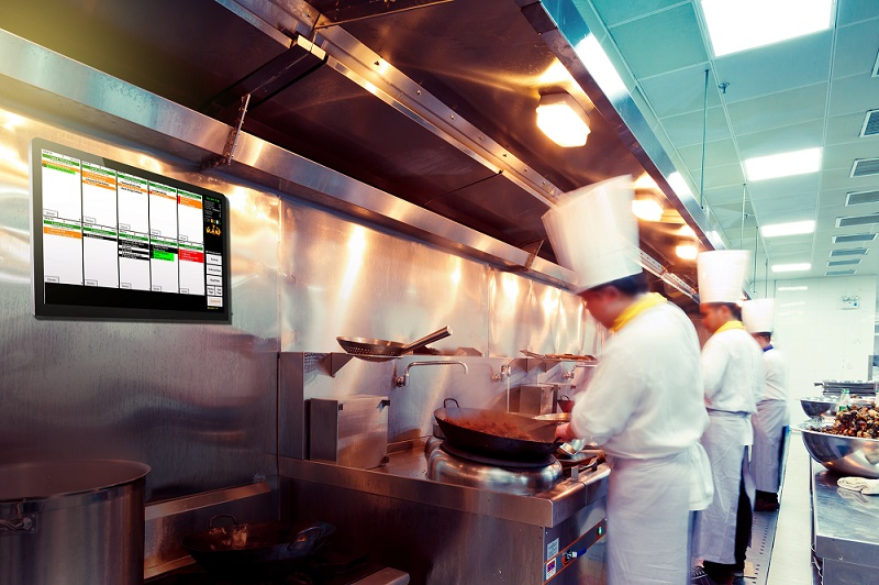 A chef working on BIM POS KMS to manage his kitchen seamlessly