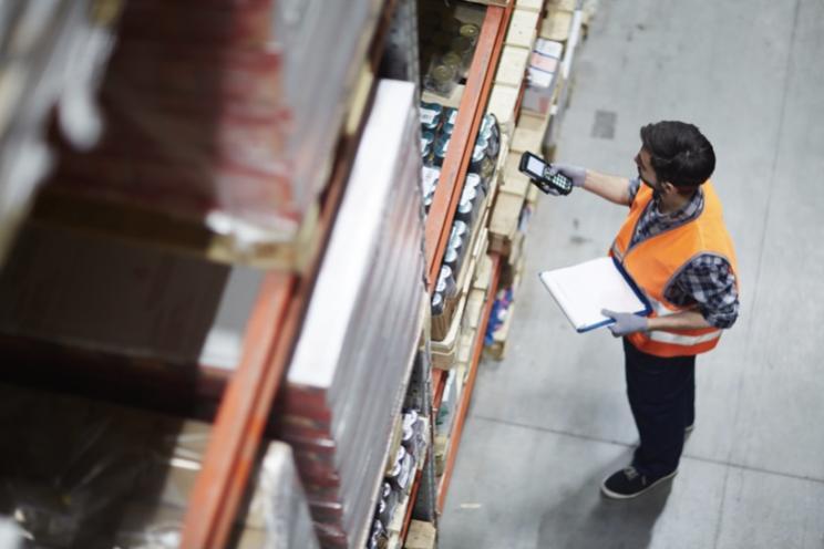 Employee managing stock in warehouse