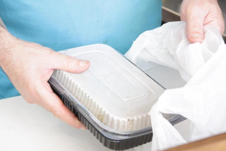 An employee preparing food order