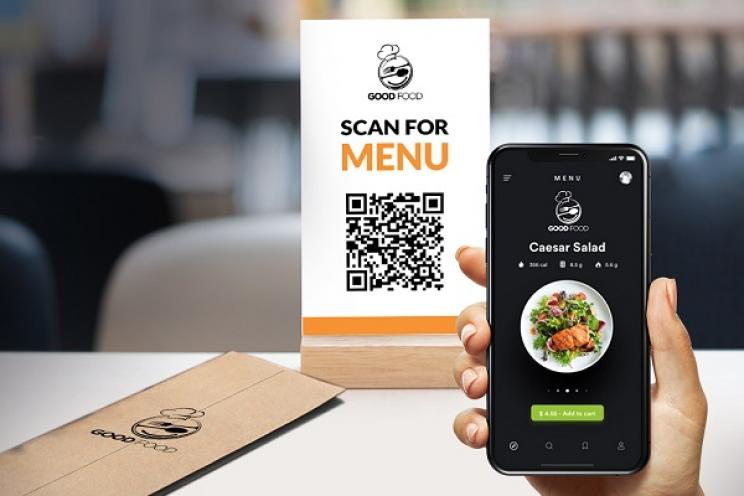 A customer scanning the QR code to explore the restaurant's digital menu
